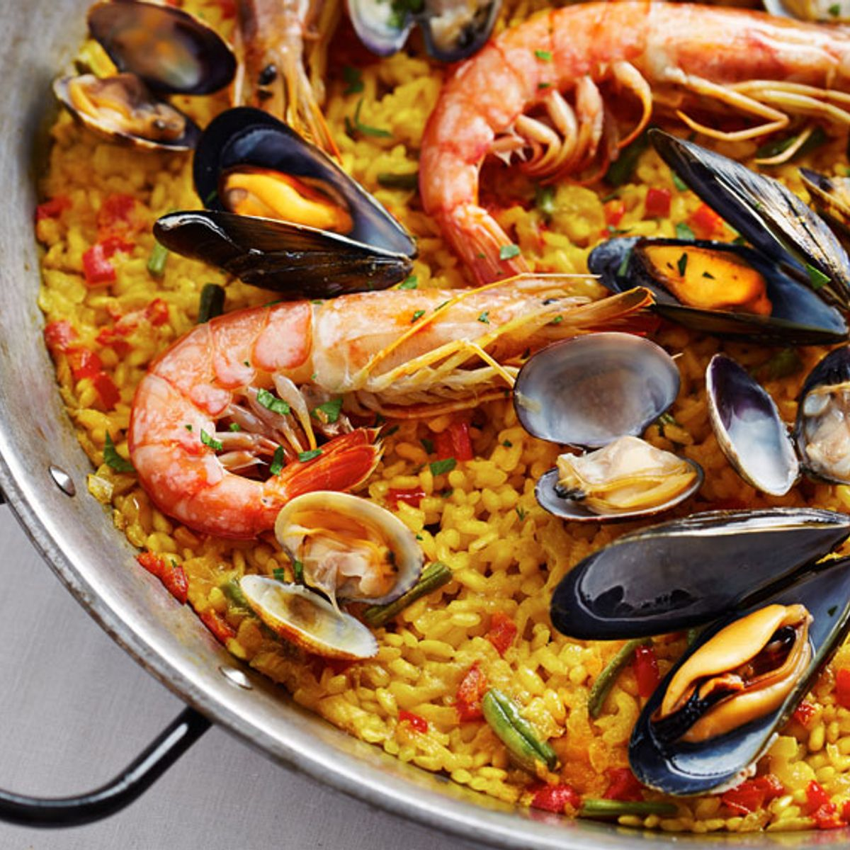 Embracing paella will blow up your mid-summer grilling game