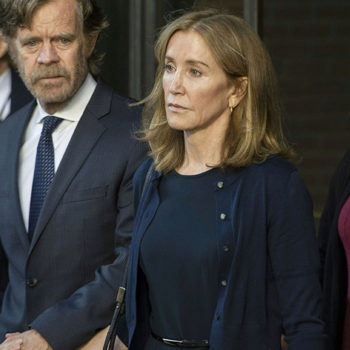 Felicity Huffman enters prison for college admissions cheating scheme