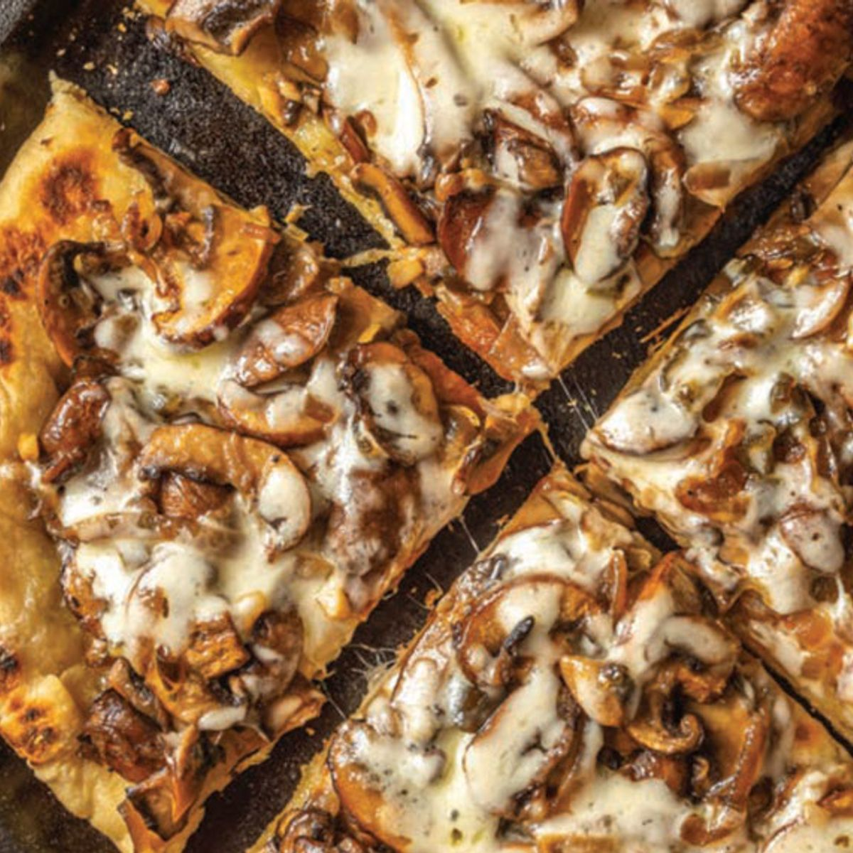 Better than delivery: This sautéed onion-mushroom flatbread is elevated by spicy-sweet jalapeños
