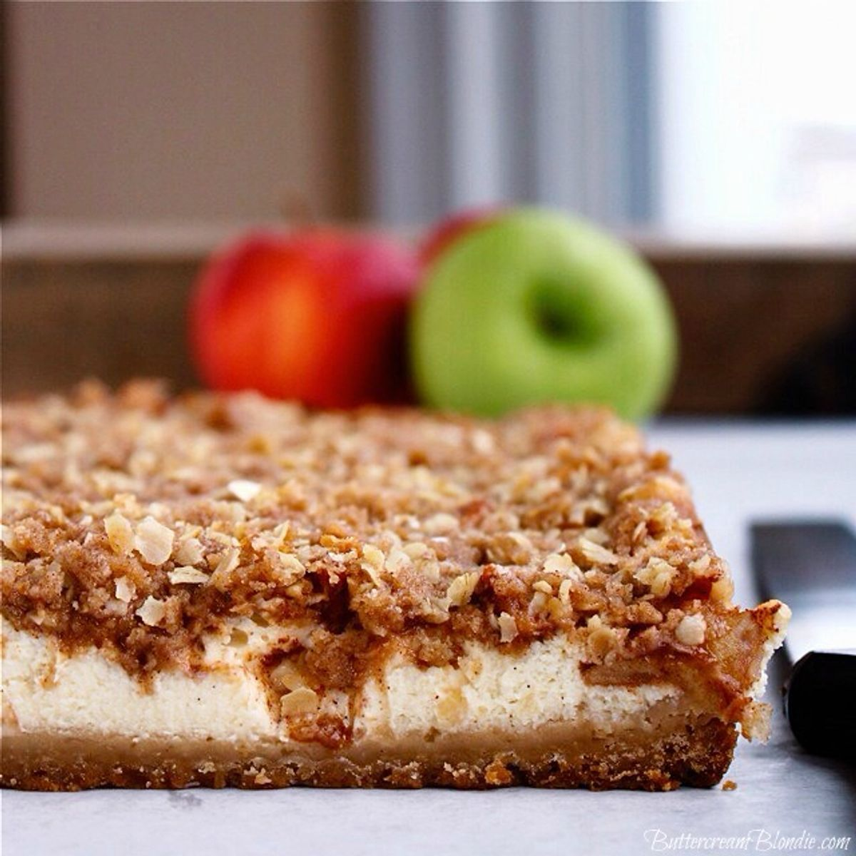 These spiked apple crisp cheesecake bars are better than any pumpkin dessert you'll have this fall