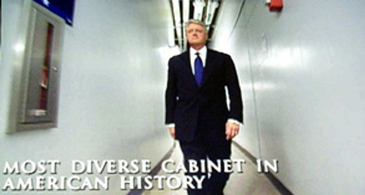 President Clinton is seen on a large television monitor walking down a backstage corridor to make his speech at the Democratic National Convention in Los Angeles, Monday, Aug. 14, 2000. (AP Photo/Hillery Smith Garrison) (Associated Press)