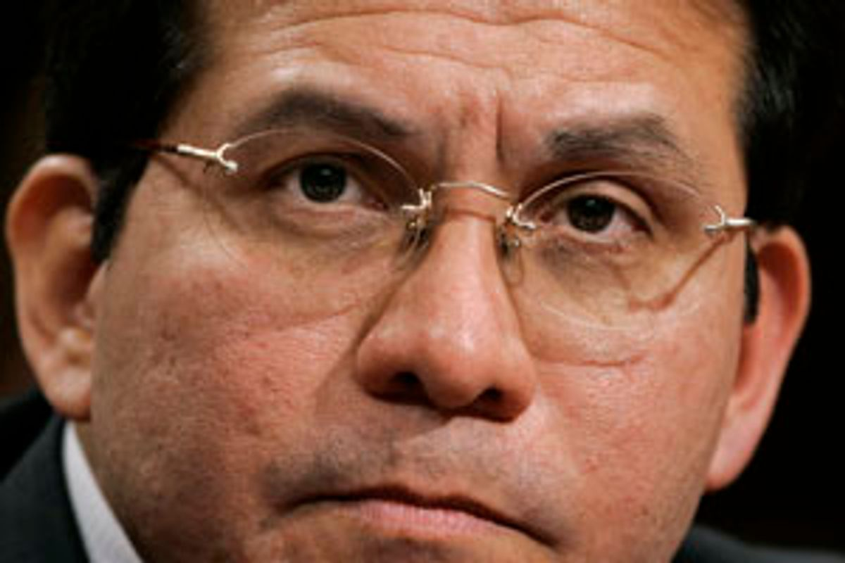 Attorney General Alberto Gonzales takes questions by the Senate Judiciary Committee on whether President Bush, and others in the executive branch, acted illegally in permitting domestic surveillance by the National Security Agency, on Capitol Hill in Washington, Monday, Feb. 6, 2006. He insisted that President Bush is fully empowered to eavesdrop on Americans without warrants as part of the war on terror and he cautioned Congress not to end or tinker with the program.  (AP Photo/J. Scott Applewhite) (J. Scott Applewhite)