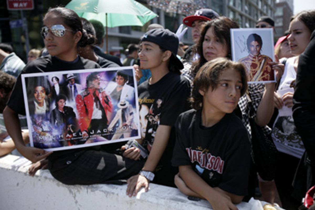 Fans outside a memorial service for Michael Jackson Tuesday, July 7, 2009, in Los Angeles