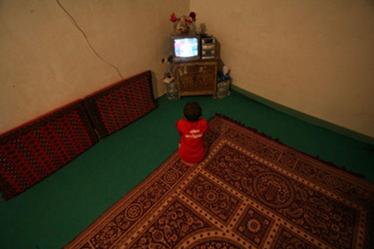 A child watches U.S. television in Bandar Abbas, Iran.