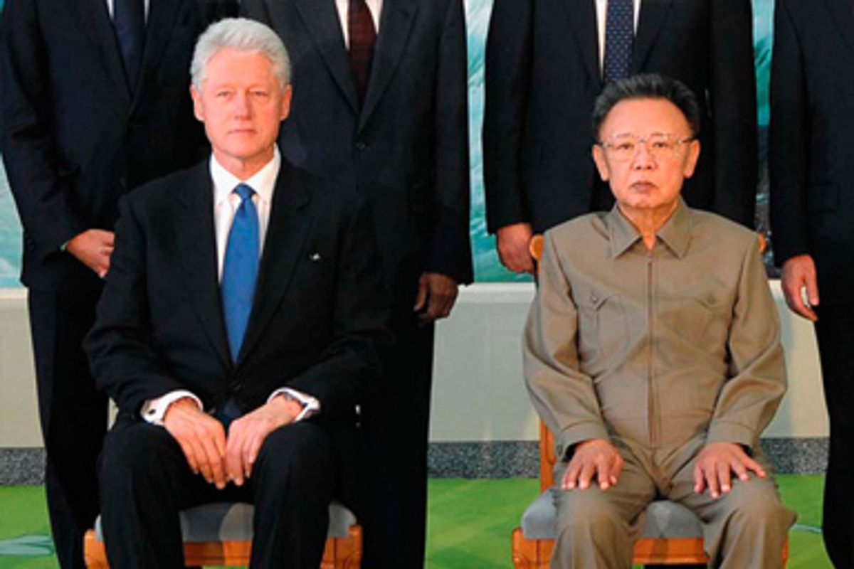 Former U.S. president Bill Clinton (seated L) and North Korea's leader Kim Jong-il (seated R) pose for a picture in Pyongyang in this photo released by North Korean official news agency KCNA August 4, 2009.