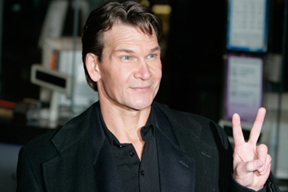 """U.S. actor Patrick Swayze gestures to fans as he arrives at the world premiere of """"Keeping Mum"""" at the Vue cinema in Leicester Square, London November 28, 2005."""