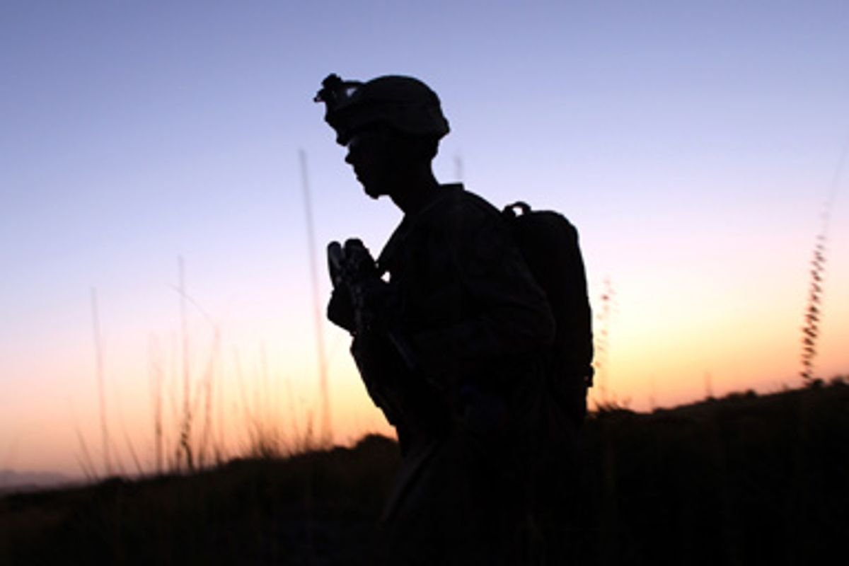 A U.S Marine from Delta Company of 2nd Light Armored Reconnaissance Battalion patrols near the town of Khan Neshin in Rig district of Helmand province, southern Afghanistan September 10, 2009.