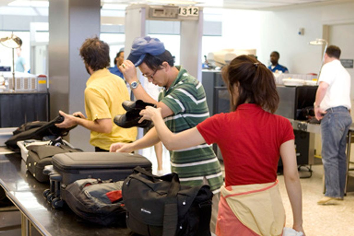 On the eve of the 8th anniversary of the September 11, 2001 attacks on the United States, travellers go through the passenger security screening facility at Dulles International Airport in Chantilly, Virginia, outside Washington, September 10, 2009.