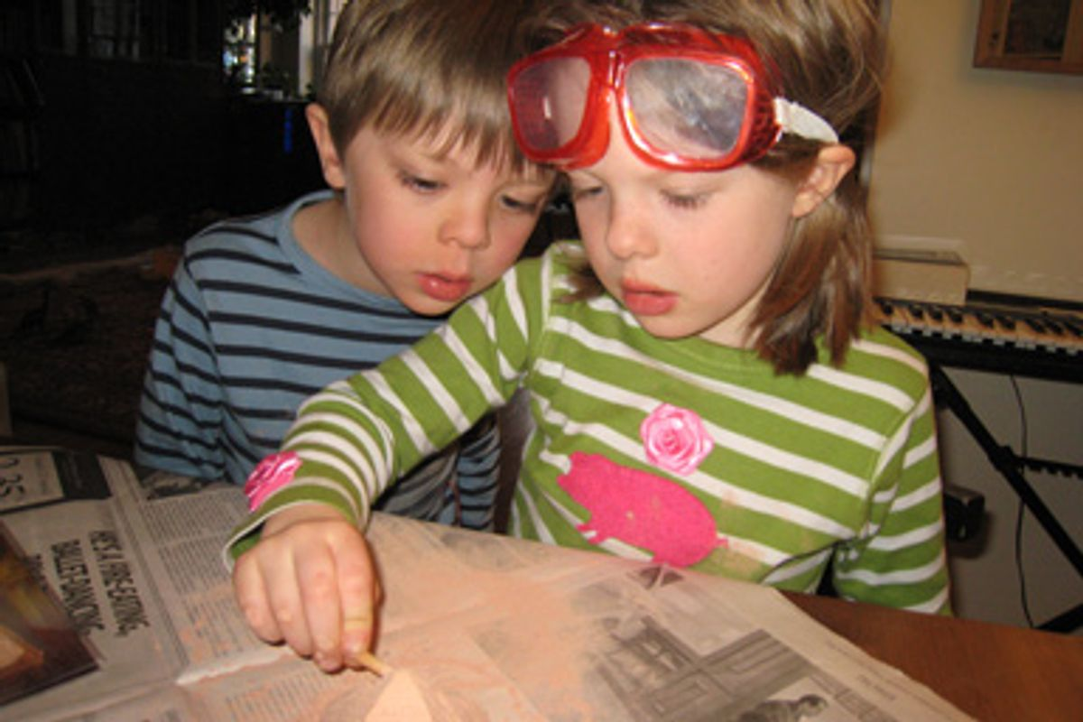 """Desmond and Nini, the author's homeschooled children, during an """"archaeological dig."""""""