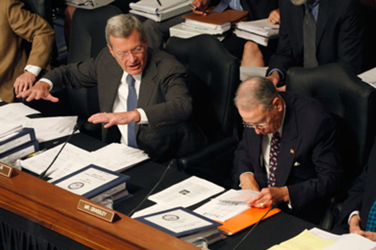 Senate Finance Committee Chairman Sen. Max Baucus, D-Mont. left, makes a point on Capitol Hill in Washington, Wednesday, Sept. 23,2009, and the committee continued working on health care legislation. The committee's ranking Republican Sen. Charles Grassley, R-Iowa is at right.