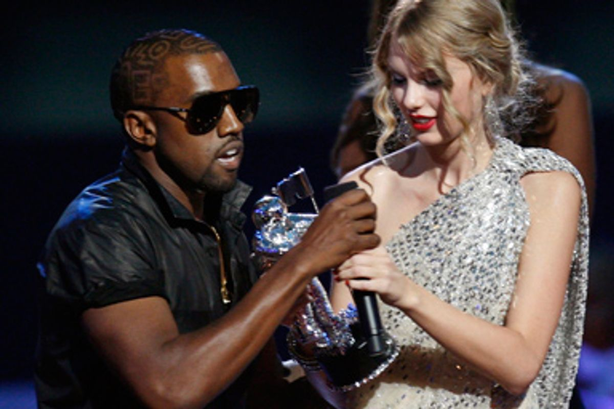 Kanye West takes the microphone from best female video winner Taylor Swift as he praises the video entry from Beyonce at the 2009 MTV Video Music Awards in New York, September 13, 2009.