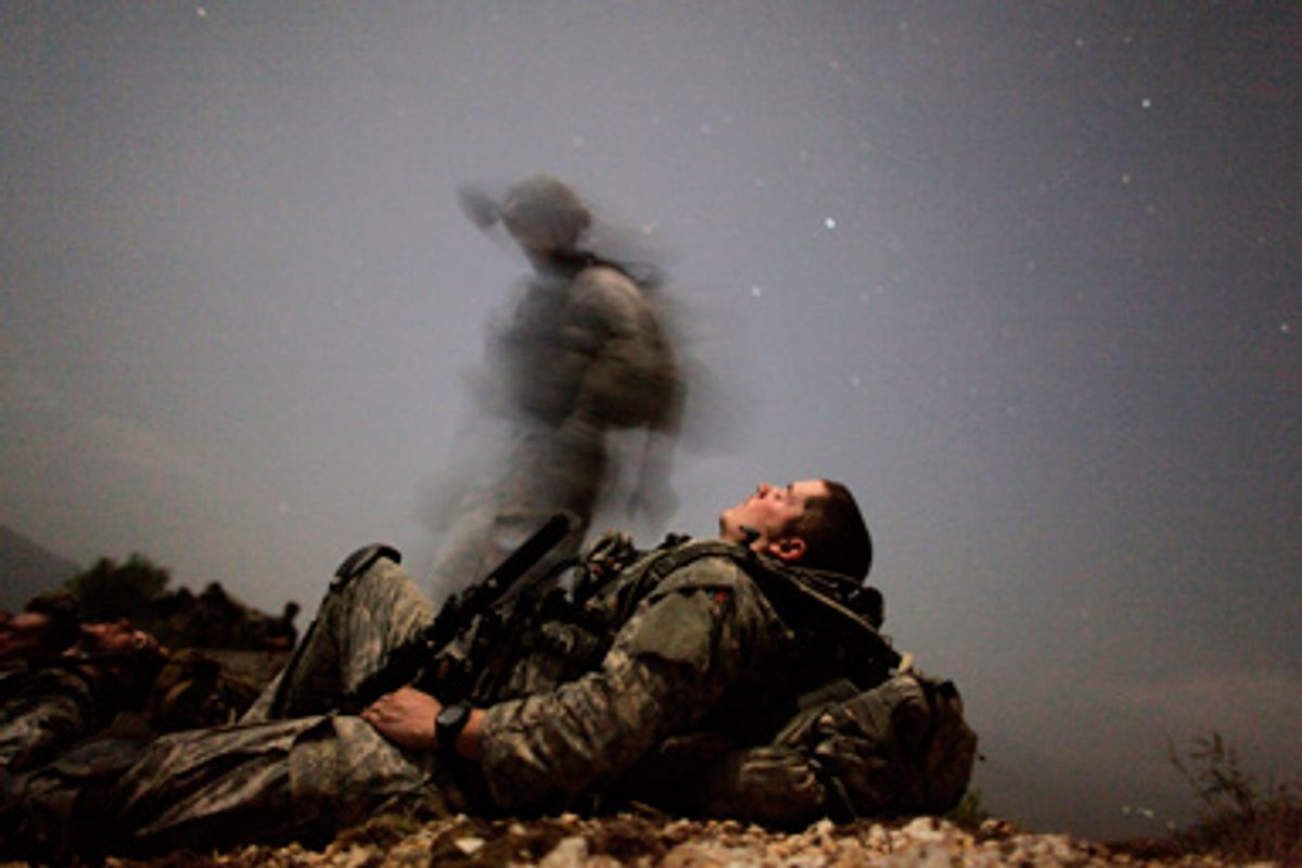 A U.S. soldier of 2-12 Infantry 4BCT-4ID Task Force Mountain Warrior takes a break during a night mission near Honaker Miracle camp at the Pesh valley of Kunar Province August 12, 2009.