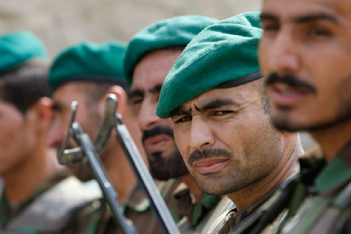Afghan National Army soldiers stand in formation during a deployment drill ahead of Afghanistan's Presidential elections in their base near the village of Pashad in Kunar province, August 15, 2009.