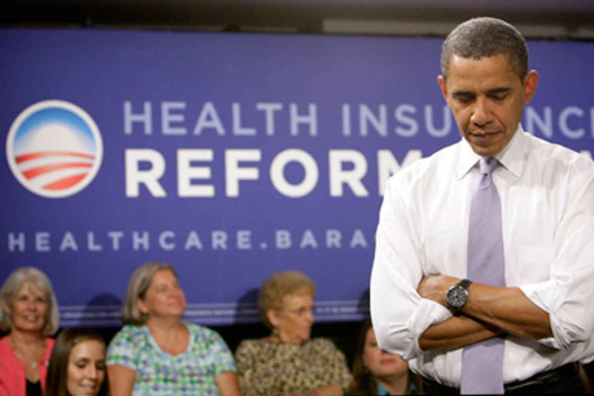 President Barack Obama listens to a question during the Organizing for America National Health Care Forum at the Democratic National Committee headquarters in Washington Thursday, Aug. 20, 2009