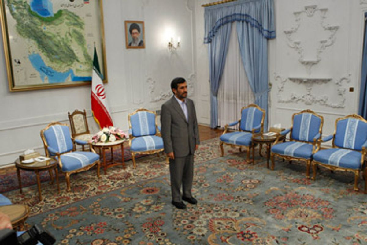 Iranian President Mahmoud Ahmadinejad waits to meet the Iraqi parliament speaker, Ayad al-Samarraie, unseen, at the presidency in Tehran, Iran, Monday, Sept. 7, 2009.