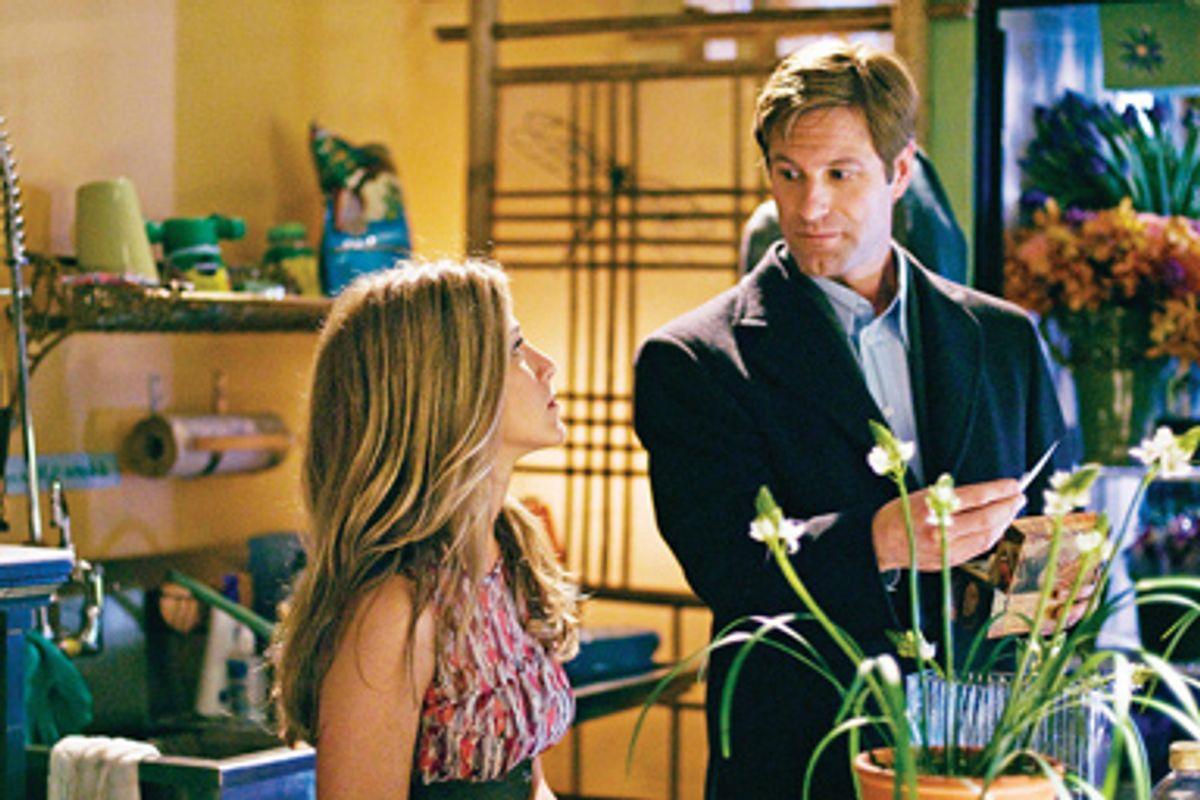 Eloise (Jennifer Aniston) and Burke (Aaron Eckhart )