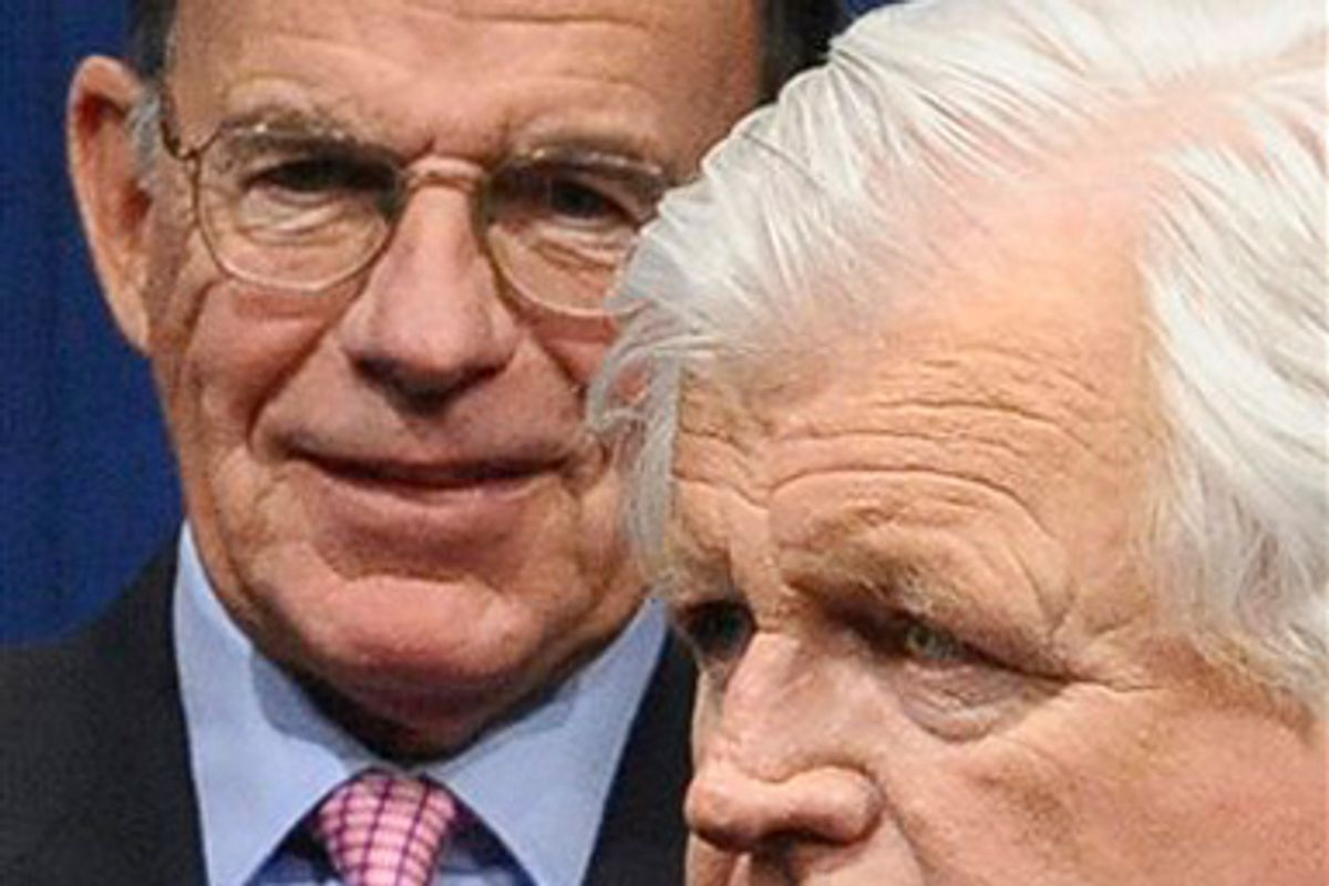 In this May 12, 2008, photo, Paul Kirk, Jr., left, chairman of the John Kennedy Library Foundation Board of Directors, is seen alongside the late Sen. Edward Kennedy at the annual Profile in Courage Award ceremonies at the John F. Kennedy Presidential Library and Museum in Boston.