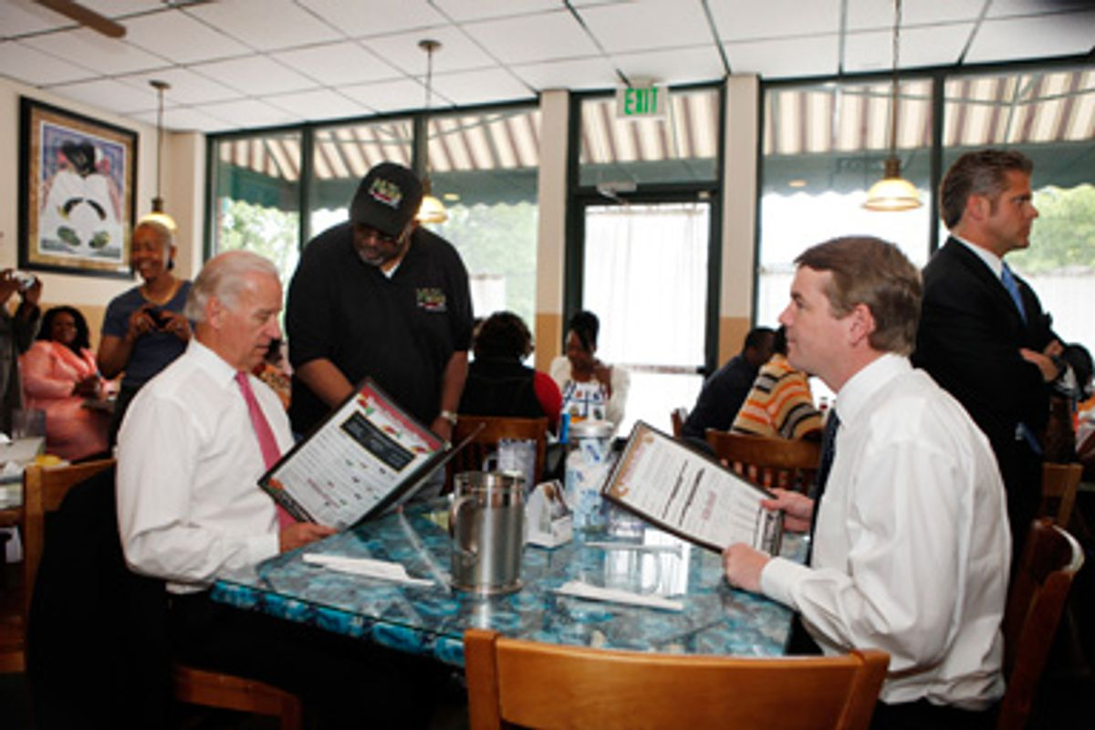 Mack Sheav takes Vice President Joe Biden food order at the M&D Cafe in Denver on Tuesday, May 26, 2009, as he sits with Sen. Michael Bennet, D-Colo.