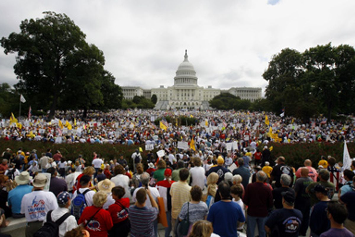 People gather on Capitol Hill in Washington, Saturday, Sept. 12, 2009, during the taxpayer rally.