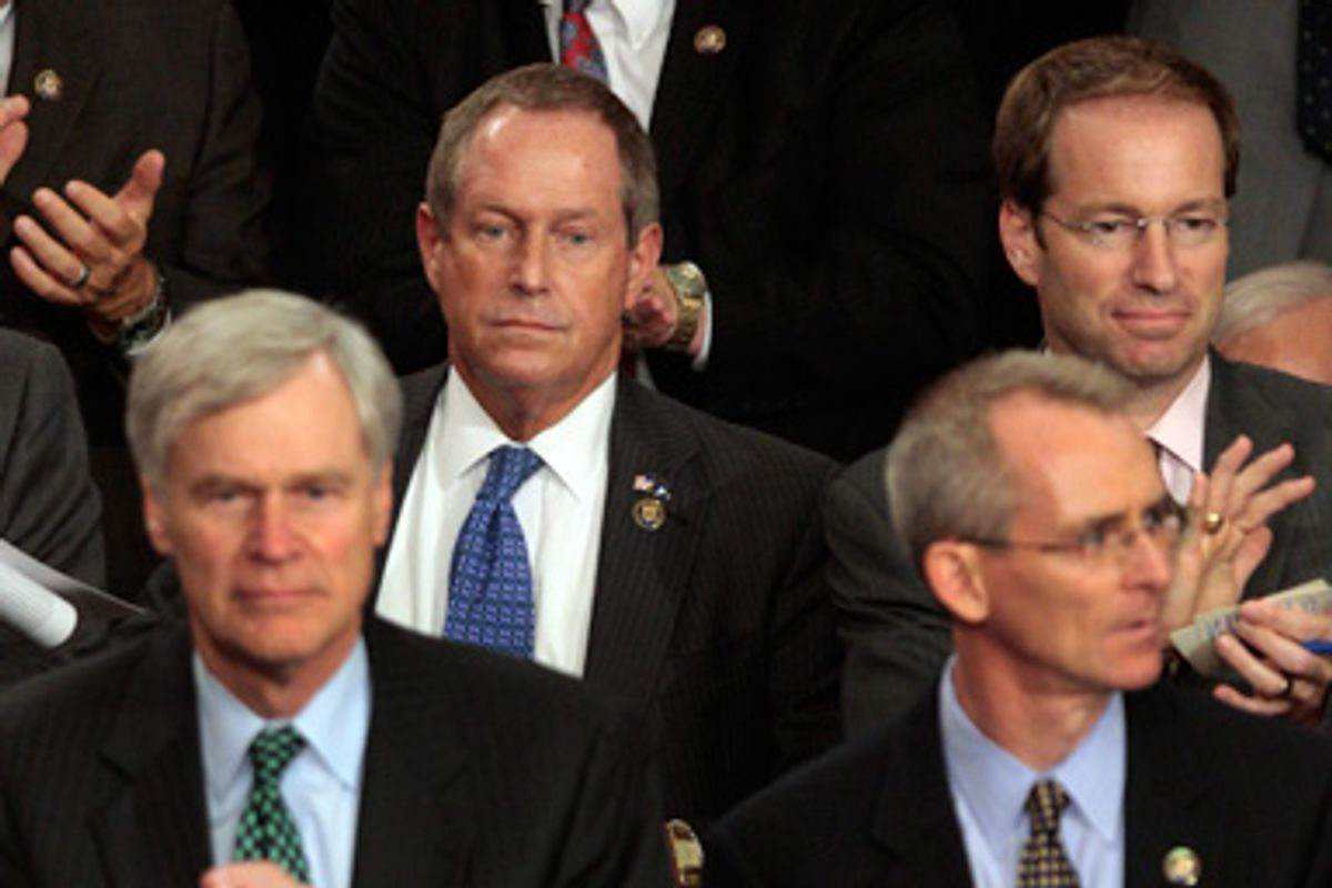 Rep. Joe Wilson, R-S.C., center, listens during President Barack Obama's speech on health care to a joint session of Congress , Wednesday, Sept., 9, 2009 on Capitol Hill in Washington.