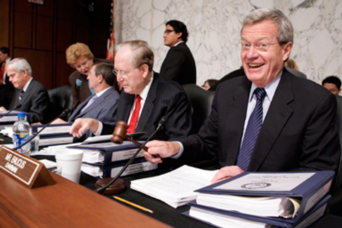 Senate Finance Committee Chairman Sen. Max Baucus, D-Mont., right, gavels the start of the markup of health care legislation on Capitol Hill in Washington, Tuesday, Sept. 29, 2009. From left are, Sen. Jeff Bingaman, D-N.M., Sen. Debbie Stabenow, D-Mich., Sen. Kent Conrad, D-N.D., Sen. Jay Rockefeller, D-W.Va., and Baucus.
