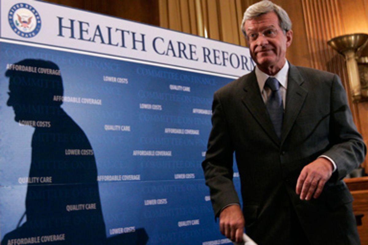 Senate Finance Committee Chairman Sen. Max Baucus, D-Mont., concludes his news conference on health care legislation, Wednesday, Sept. 16, 2009, Capitol Hill in Washington.