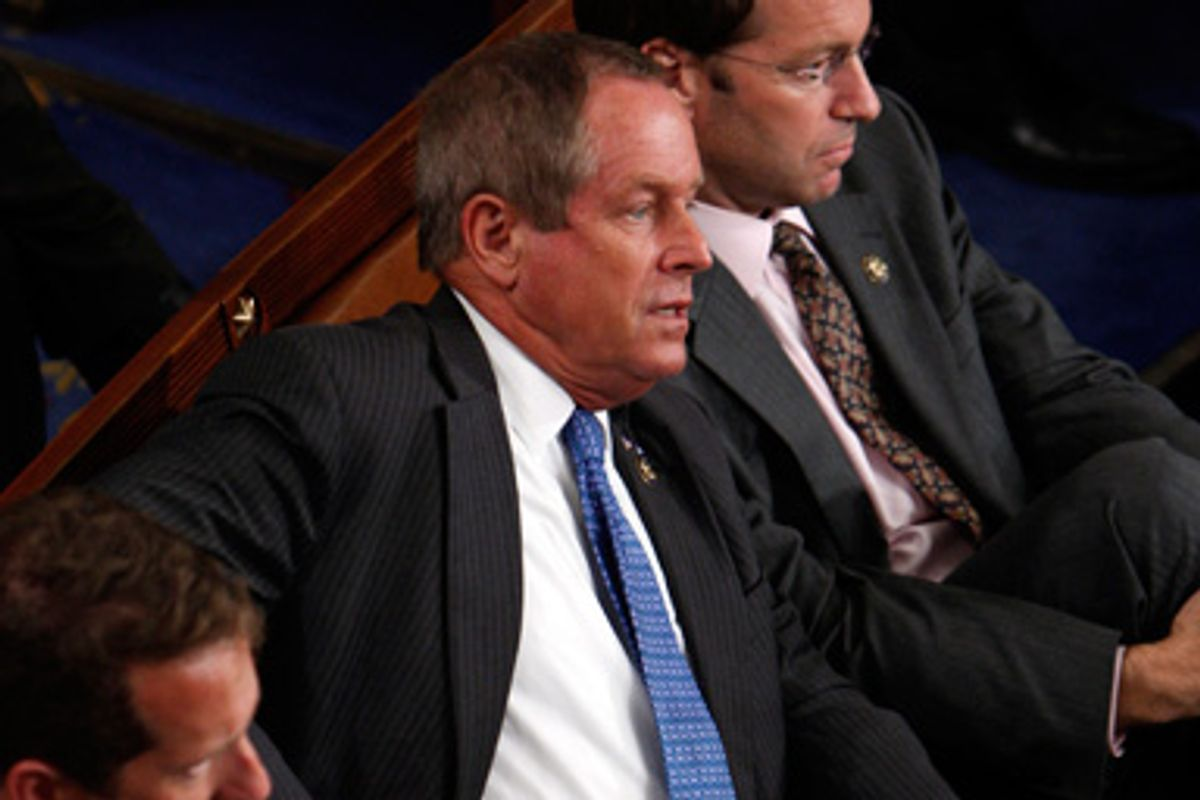 """U.S. Representative Joe Wilson of South Carolina listens to President Obama's speech after yelling out """"You Lie"""" during the President's speech about healthcare reform to a joint session of the Congress on Capitol Hill in Washington, September 9, 2009."""