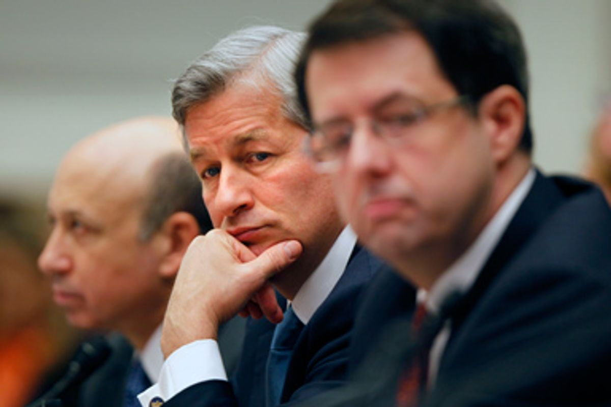 JPMorgan Chase & Co. Chief Executive Officer James Dimon, center, flanked by Goldman Sachs & Co. Chief Executive Officer and Chairman Lloyd C. Blankfein, left, and Bank of New York Mellon Chairman Chief Executive Officer Robert Kelly, are seen on Capitol Hill in Washington, Wednesday, Feb. 11,2009, during a House Financial Services Committee hearing.