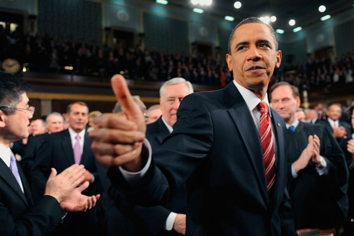 Barack Obama greets members of Congress on his way to deliver his first State of the Union address.