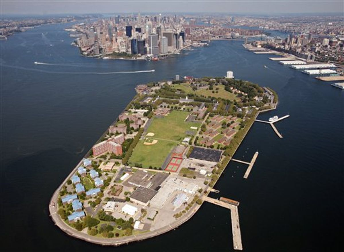 FILE - This Sept. 8, 2008 file aerial photo shows Governors Island in New York harbor, with lower Manhattan in the background center. Manhattan community activists are pushing a host of alternative locales for the trial of admitted 9/11 mastermind Khalid Sheikh Mohammed and four terror suspects in a bid to keep the spectacle out of their neighborhood. The suggestions include Governors Island, an air base in Newburgh and an old prison in upstate New York. (AP Photo/Mark Lennihan, file) (AP)