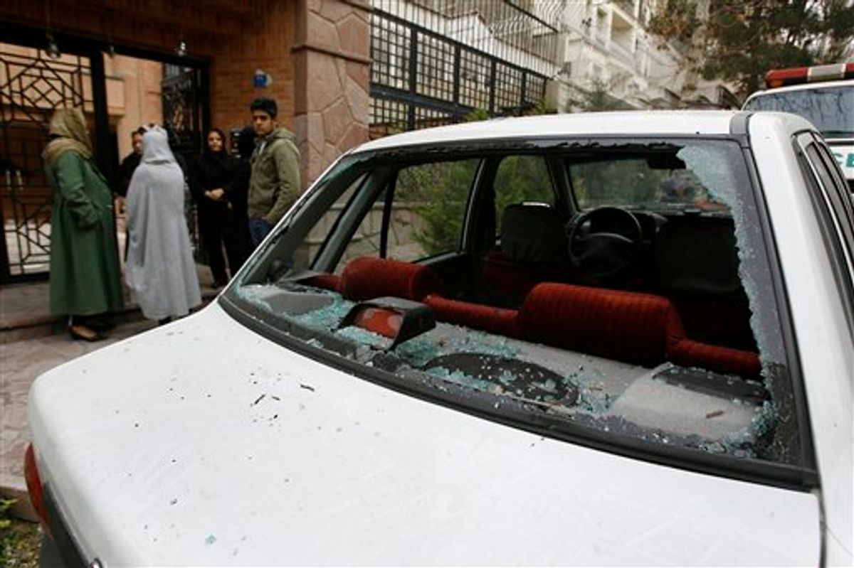 The window of a car is shattered after a bomb blast which killed  Iranian nuclear physics professor Massoud Ali Mohammadi, in front of his house, in northern Tehran's Qeytariyeh neighborhood, Tuesday, Jan. 12, 2010. A nuclear physics professor at Tehran University was killed Tuesday by a bomb-rigged motorcycle parked outside his home in Iran's capital, state media reported. (AP Photo,ISNA,Mona Hoobehfekr) (AP)