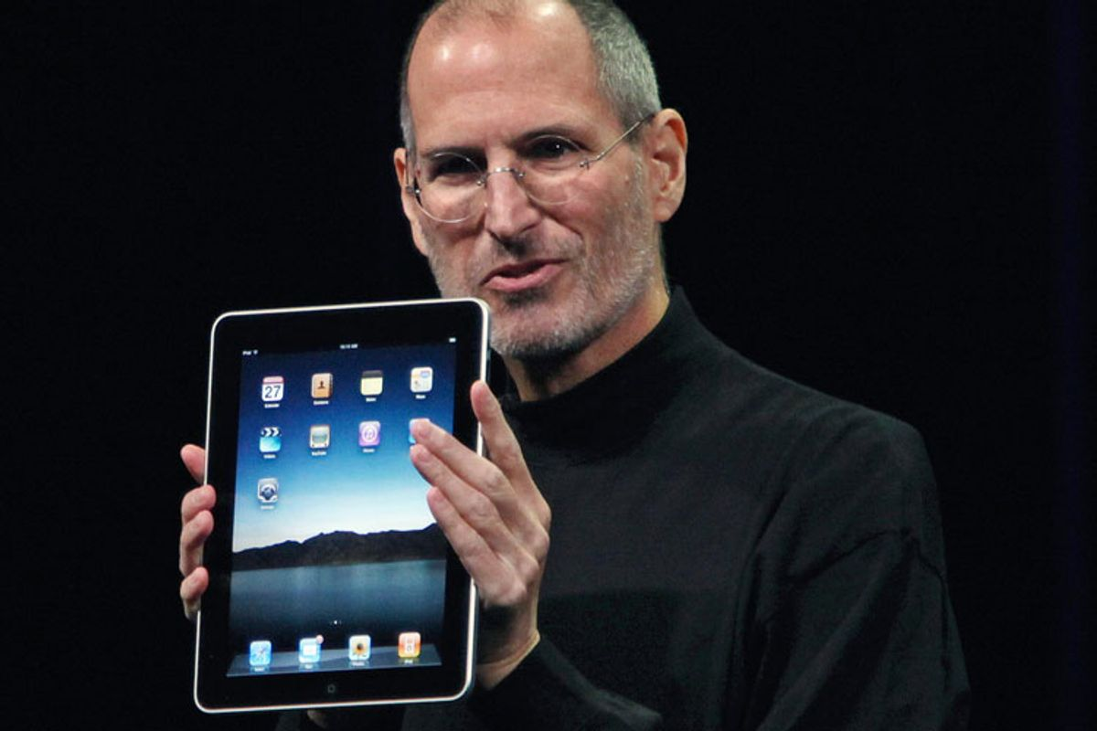 Apple CEO Steve Jobs holds the new iPad during the launch of the new tablet computing device in San Francisco Wednesday.