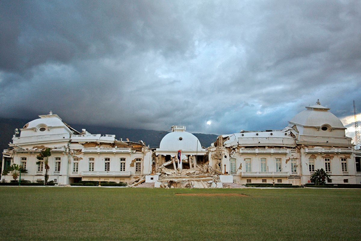 Haiti's National Palace is seen after in Port-au-Prince,  Wednesday, Jan. 13, 2010, the day after a powerful earthquake hit the country. (AP Photo/Ricardo Arduengo)   (Ricardo Arduengo)