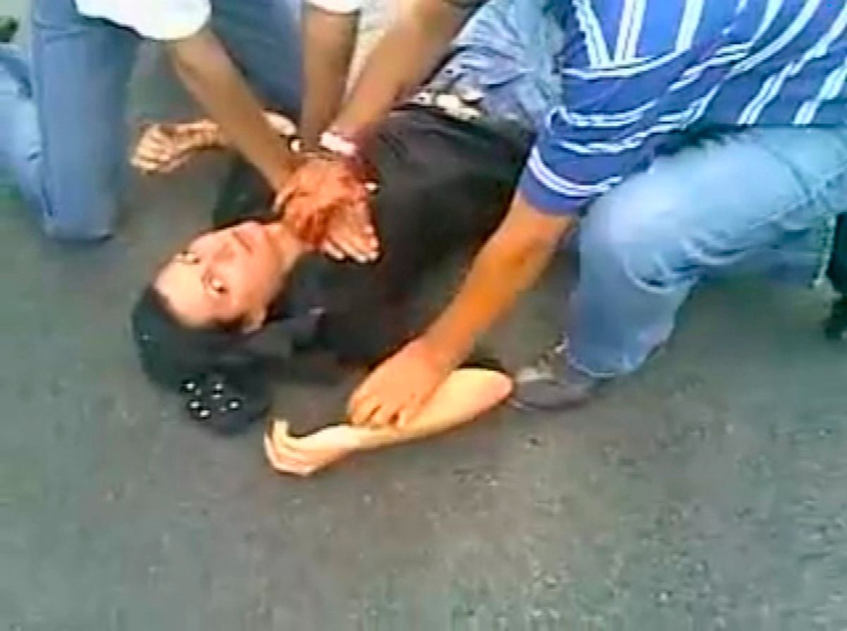"""EDITORS' NOTE: Reuters and other foreign media are subject to Iranian restrictions on their ability to report, film or take pictures in Tehran.   A frame grab from YouTube shows a woman identified as Neda Agha-Soltan lying on the ground after getting shot in the chest in Tehran June 20, 2009. Iranians on social networking sites called for mourning for """"Neda"""", a young woman shot dead on Saturday. Footage of her death has been watched by thousands on the Internet and her image has become an icon of the protests.    REUTERS/YouTube   (IRAN POLITICS ELECTIONS CONFLICT) QUALITY FROM SOURCE. FOR EDITORIAL USE ONLY. NOT FOR SALE FOR MARKETING OR ADVERTISING CAMPAIGNS (Reuters)"""