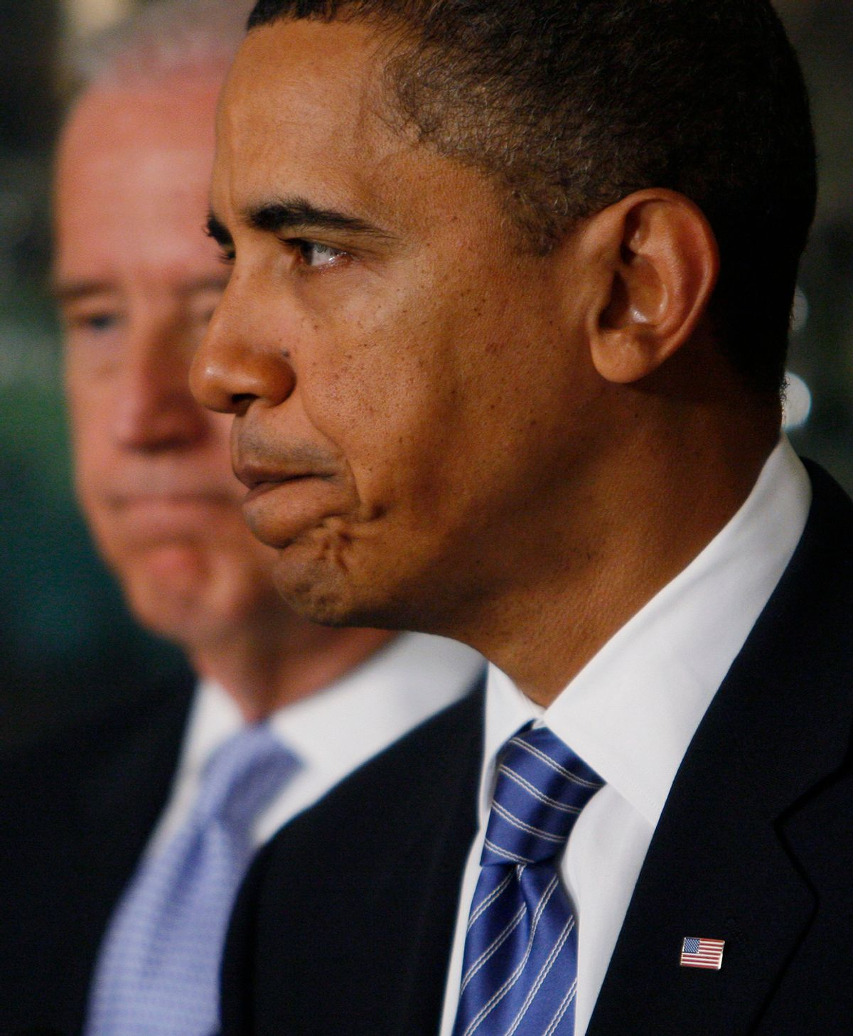 President Barack Obama stands with Vice President Joe Biden as he makes a statement about the earthquake in Haiti,Thursday, Jan. 14, 2010, at the White House in Washington. (AP Photo/Charles Dharapak)  (Associated Press)