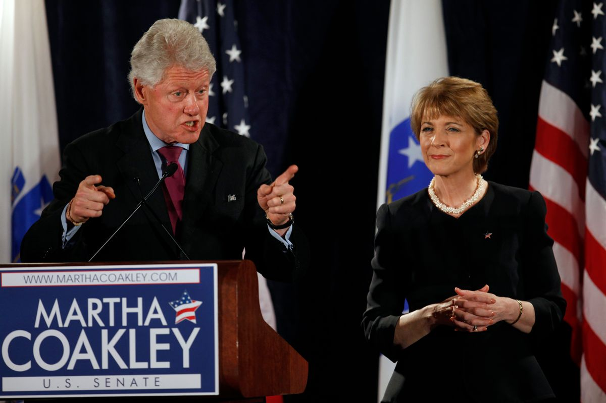 Former President Bill Clinton, left, addresses an audience as Martha Coakley, right, a candidate for the U.S. Senate seat left empty by the death of Sen. Edward M. Kennedy, D-Mass., looks on during a campaign rally in Boston, Friday, Jan. 15, 2010. (AP Photo/Steven Senne) (Associated Press)
