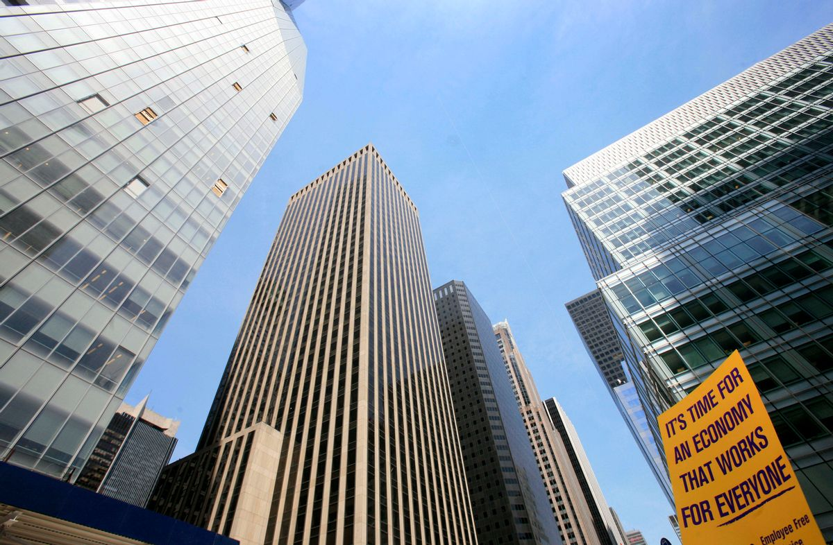 A protest sign is held up outside the Bank of America Tower, left, Tuesday, April 28, 2009 in New York.  Protests are planned nationwide against Bank of America in advance of its shareholders meeting Wednesday. (AP Photo/Mark Lennihan) (Mark Lennihan)