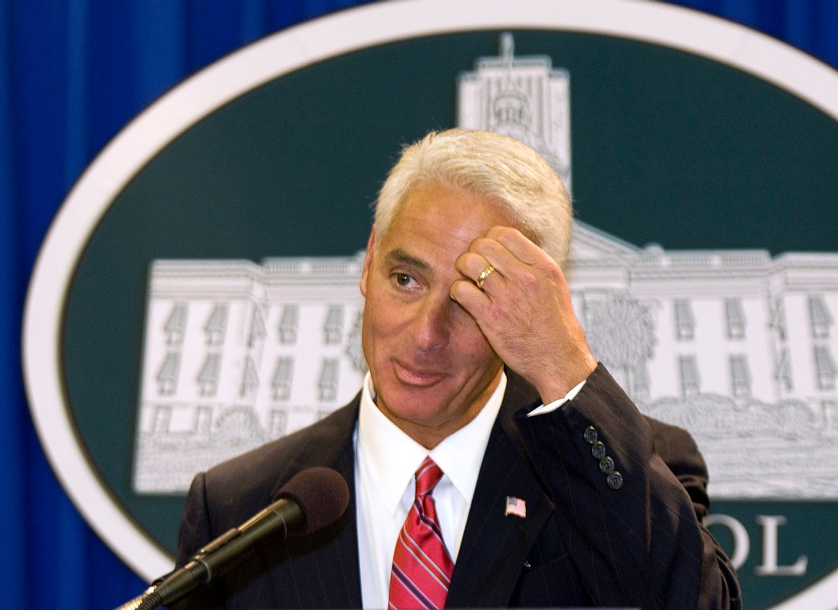 Florida's Governor Charlie Crist (C) attends a news conference to officially announce that he will be running for the US Senate, at the Florida Capitol in Tallahassee May 12, 2009.  REUTERS/Mark Wallheiser  (UNITED STATES POLITICS) (Reuters)