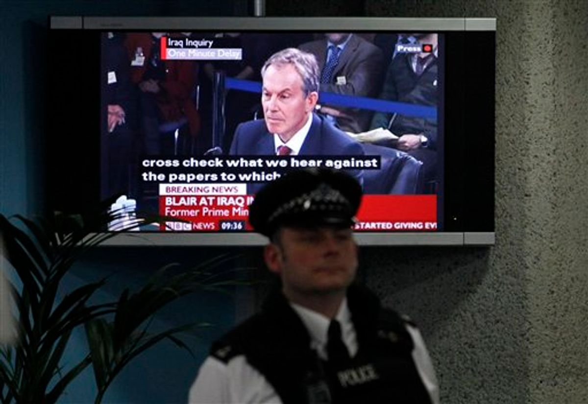 A police officer stands in front of a television screen in the foyer of the venue hosting the Iraq Inquiry in London, as Britain's former Prime Minister Tony Blair speaks, Friday, Jan. 29, 2010. Blair faced tough questioning Friday on his controversial decision to back the 2003 U.S.-led invasion of Iraq, a pledge that led to widespread protests in Britain and weakened his standing as leader. (AP Photo/Matt Dunham) (AP)