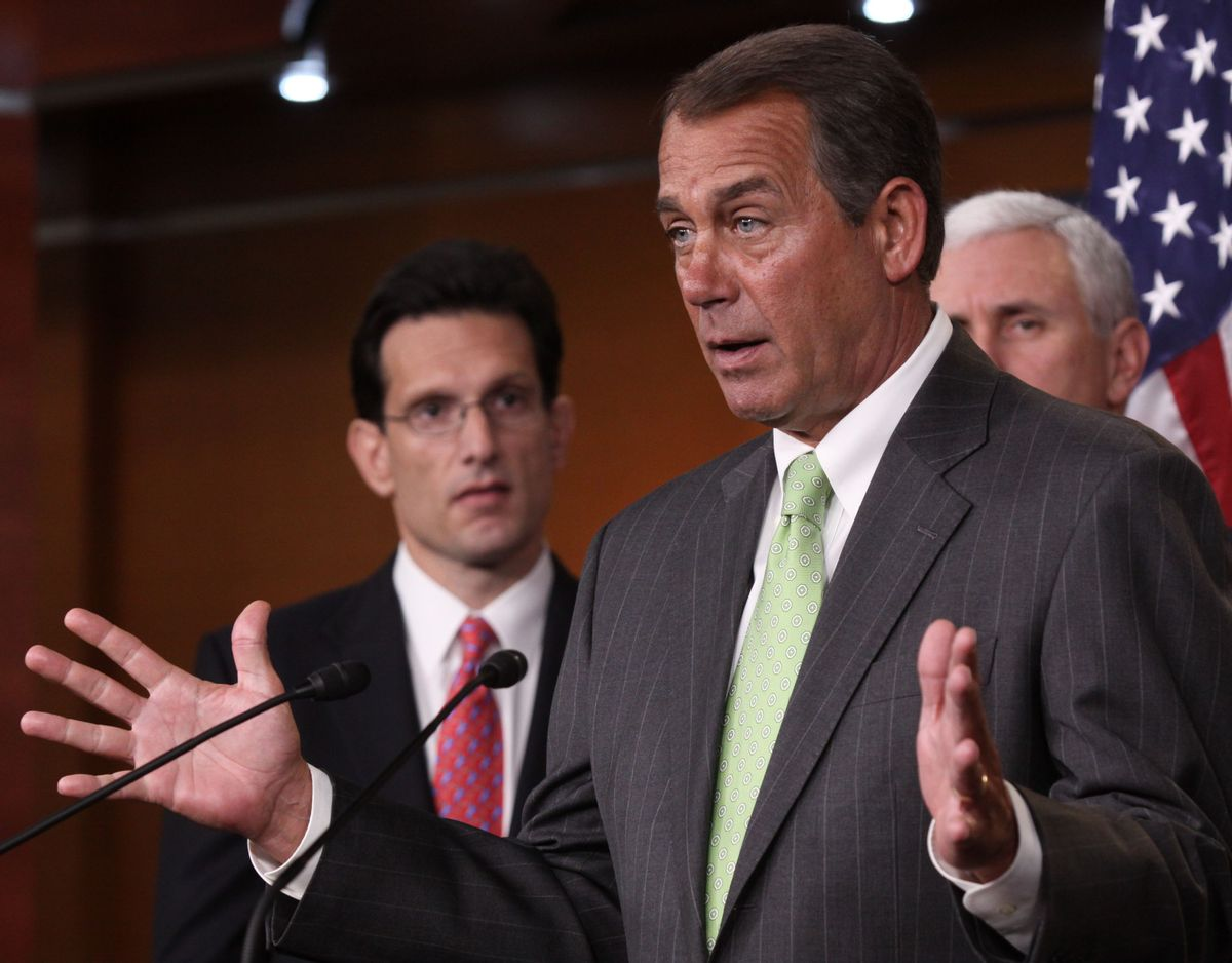House Minority Leader John Boehner of Ohio, center, accompanied by House Minority Whip Eric Cantor of Va., left, and Rep. Mike Pence, R-Ind., gestures during a news conference on Capitol Hill in Washington, Wednesday, Jan. 20, 2010, to talk about the  Massachusetts Senate election. (AP Photo/Lauren Victoria Burke)       (Associated Press)
