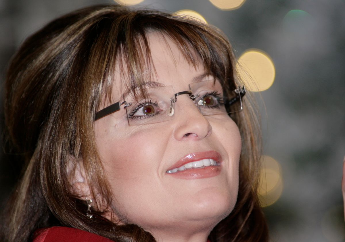 """Sarah Palin greets fans at a book signing event for her new book """"Going Rouge"""" at the Mall of America in Bloomington, Minn. Dec. 7, 2009.(AP Photo/Andy King) (Andy King)"""