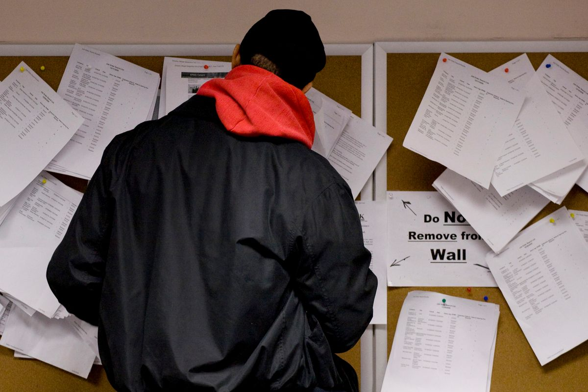 A man searches through job listings in the New York State Labor Department's Division of Employment Services in Brooklyn, N.Y., Wednesday, Jan. 6, 2010. The Labor Department reports on unemployment and jobless claims this week. (AP Photo/Mark Lennihan) (Mark Lennihan)