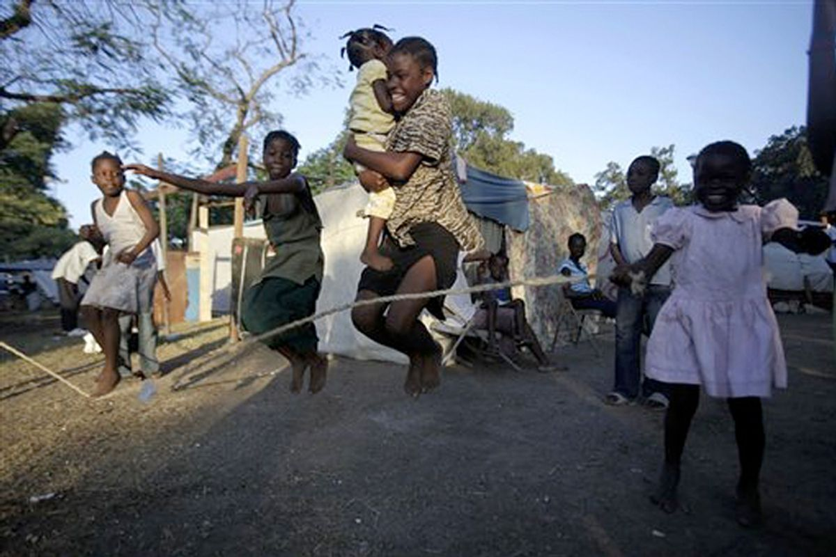 Girls play jump-rope at a makeshift camp in Port-au-Prince, Haiti, on Jan. 21.