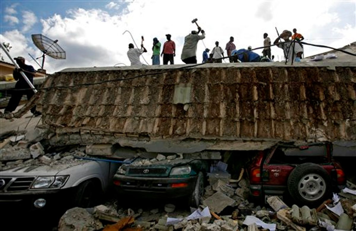 People search for survivors under the rubble of a collapse building the day after an earthquakehit Port-au-Prince, Haiti, Wednesday, Jan. 13, 2010.  The 7.0-magnitude earthquake that hit Haiti on Tuesday flattened the president's palace, the cathedral, hospitals, schools, the main prison and whole neighborhoods. (AP Photo/Ricardo Arduengo)  (AP)