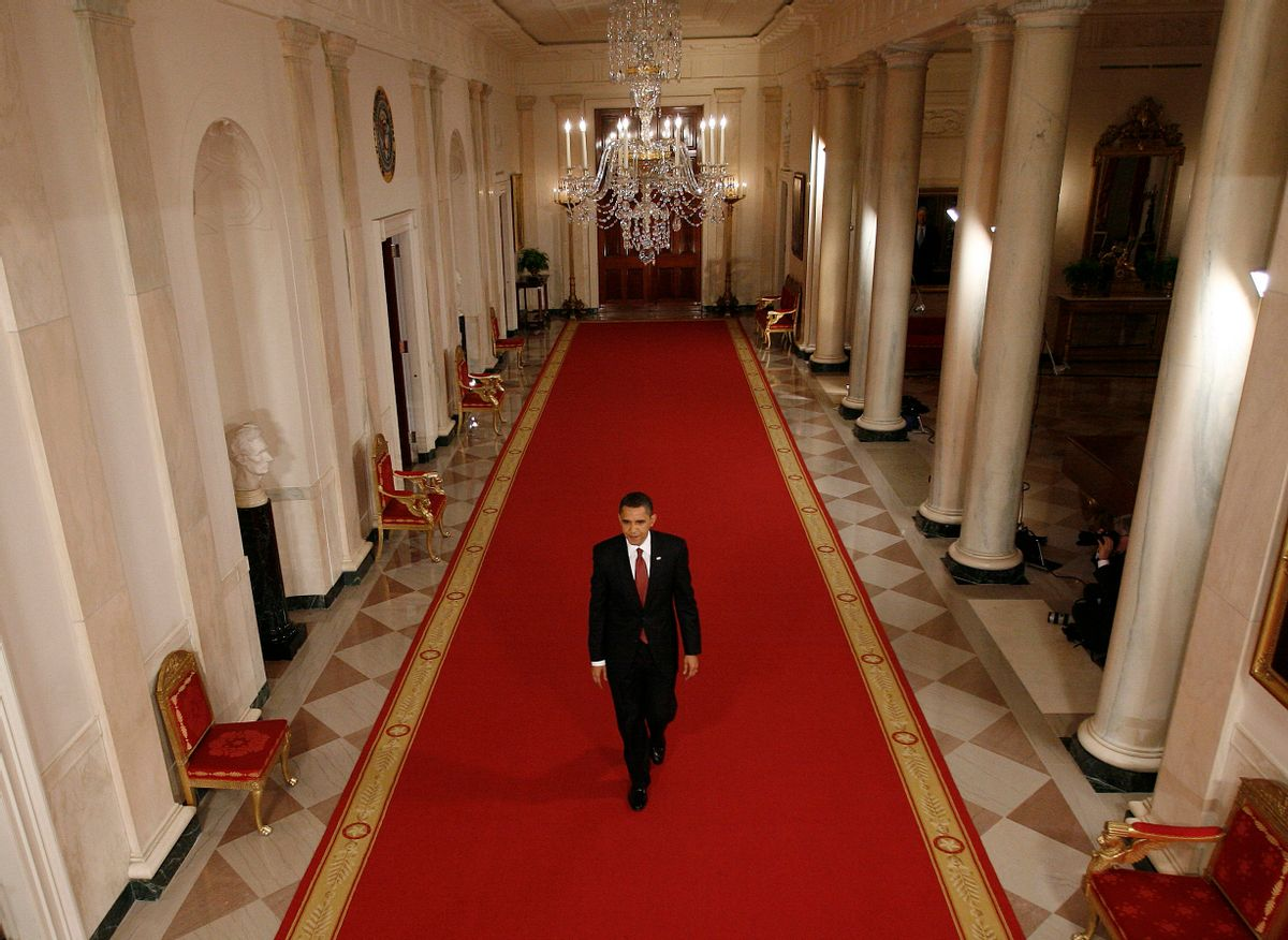 U.S. President Barack Obama walks down the White House Cross Hall to the East Room for a nationally-televised news conference in Washington, March 24, 2009.       REUTERS/Jason Reed   (UNITED STATES POLITICS BUSINESS) (Reuters)