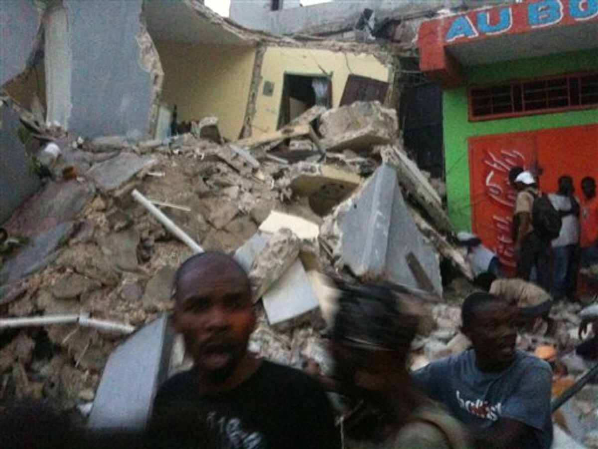 **RETRANSMISSION FOR IMPROVED QUALITY** This photo provided by Carel Pedre shows people running past rubble of a damaged building in Port-au-Prince, Haiti, Tuesday, Jan. 12, 2010. The largest earthquake ever recorded in the area shook Haiti on Tuesday, collapsing a hospital where people screamed for help. (AP Photo/Carel Pedre) MANDATORY CREDIT: CAREL PEDRE; NO SALES  (AP)