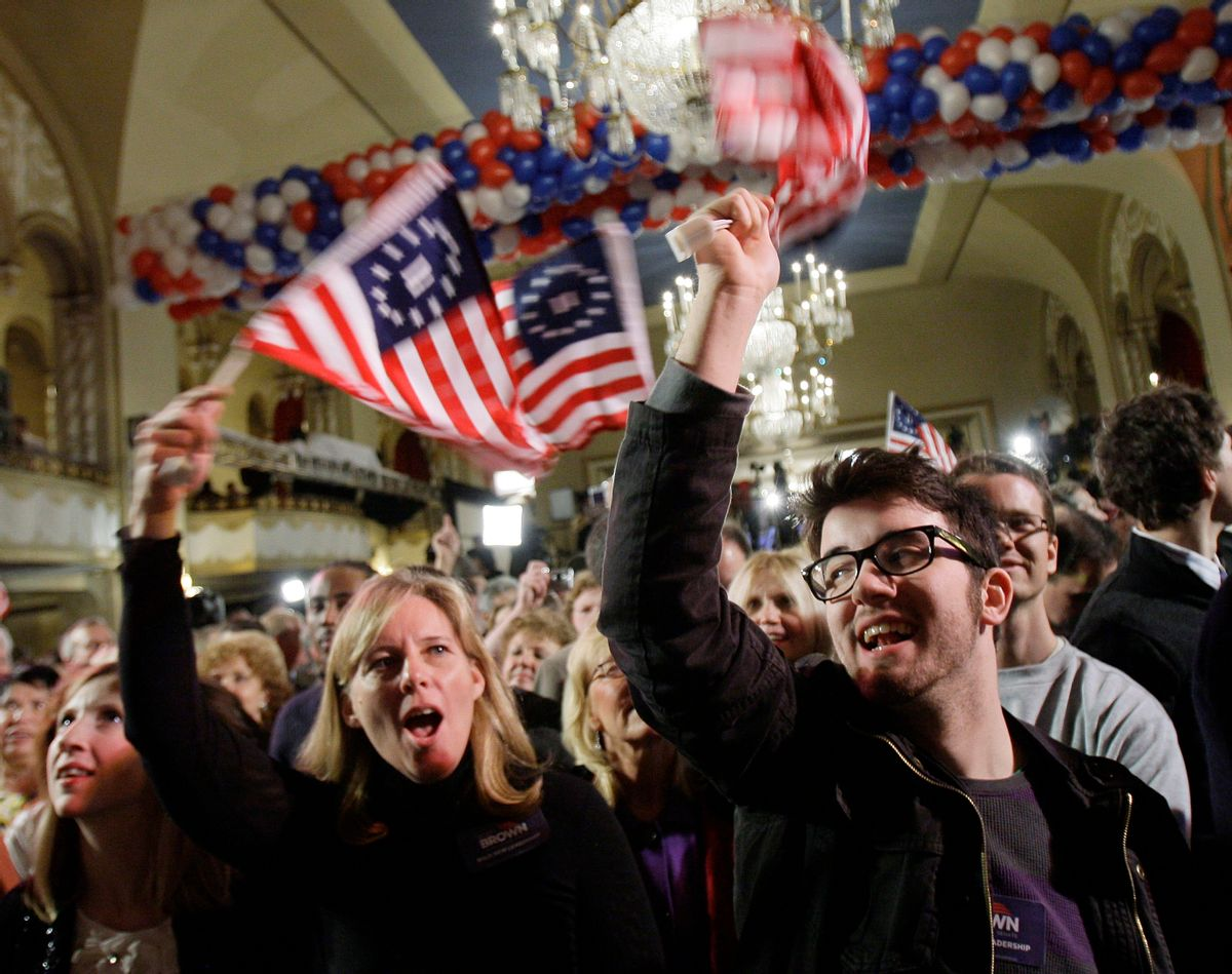 Supporters of Massachusetts State Sen. Scott Brown, R-Wrentham, Barbara Ann O'Neill, left, of Wrentham, Mass., and Jacob Porter, right, of Bucks County, Penn., wave flags before results are announced at Brown's election-night headquarters in Boston, Tuesday, Jan. 19, 2010. Brown is on the ballot of a special election held to fill the U.S. Senate seat left vacant by the death of Sen. Edward Kennedy. He is running against Massachusetts Attorney General Martha Coakley, a Democrat, and Joseph L. Kennedy, a Libertarian running as an independent and not related to the late Sen. Kennedy.  (AP Photo/Elise Amendola) (Elise Amendola)