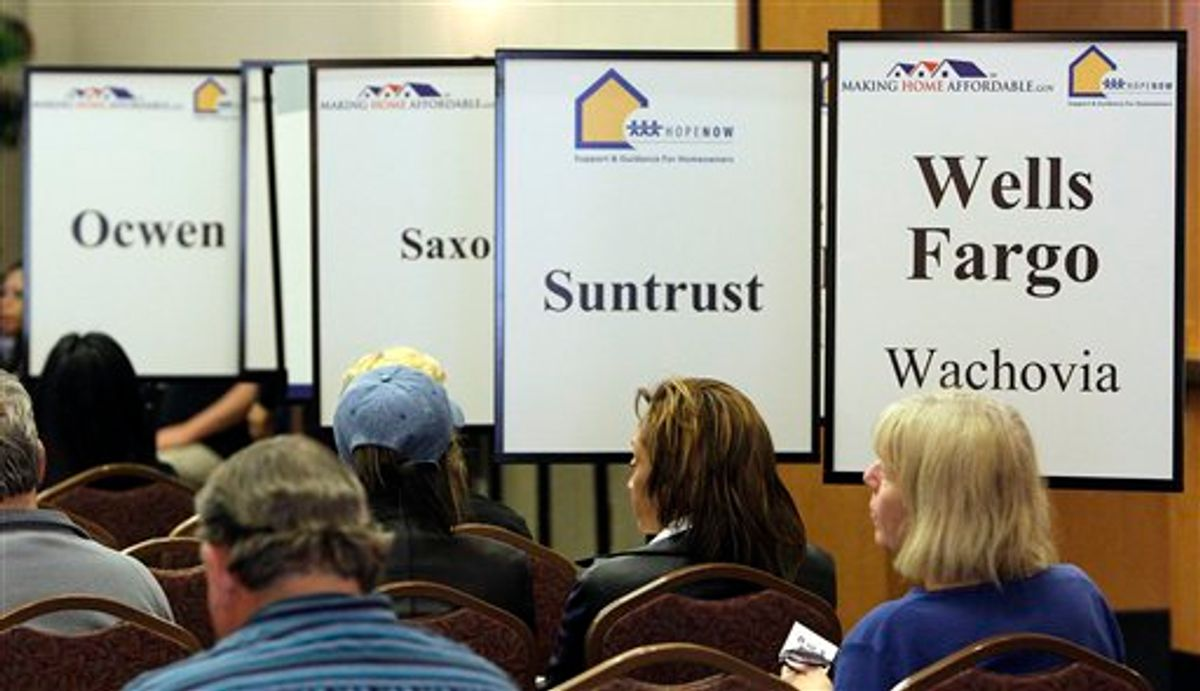 Hundreds of Arizona homeowners came to meet with housing counselors and representatives from major lenaders, Thursday, March 11, 2010, in Glendale, Ariz. The outreach event was organized by federal agencies under the Obama Administration's Making Home Affordable program. (AP Photo/Ross D. Franklin) (AP)