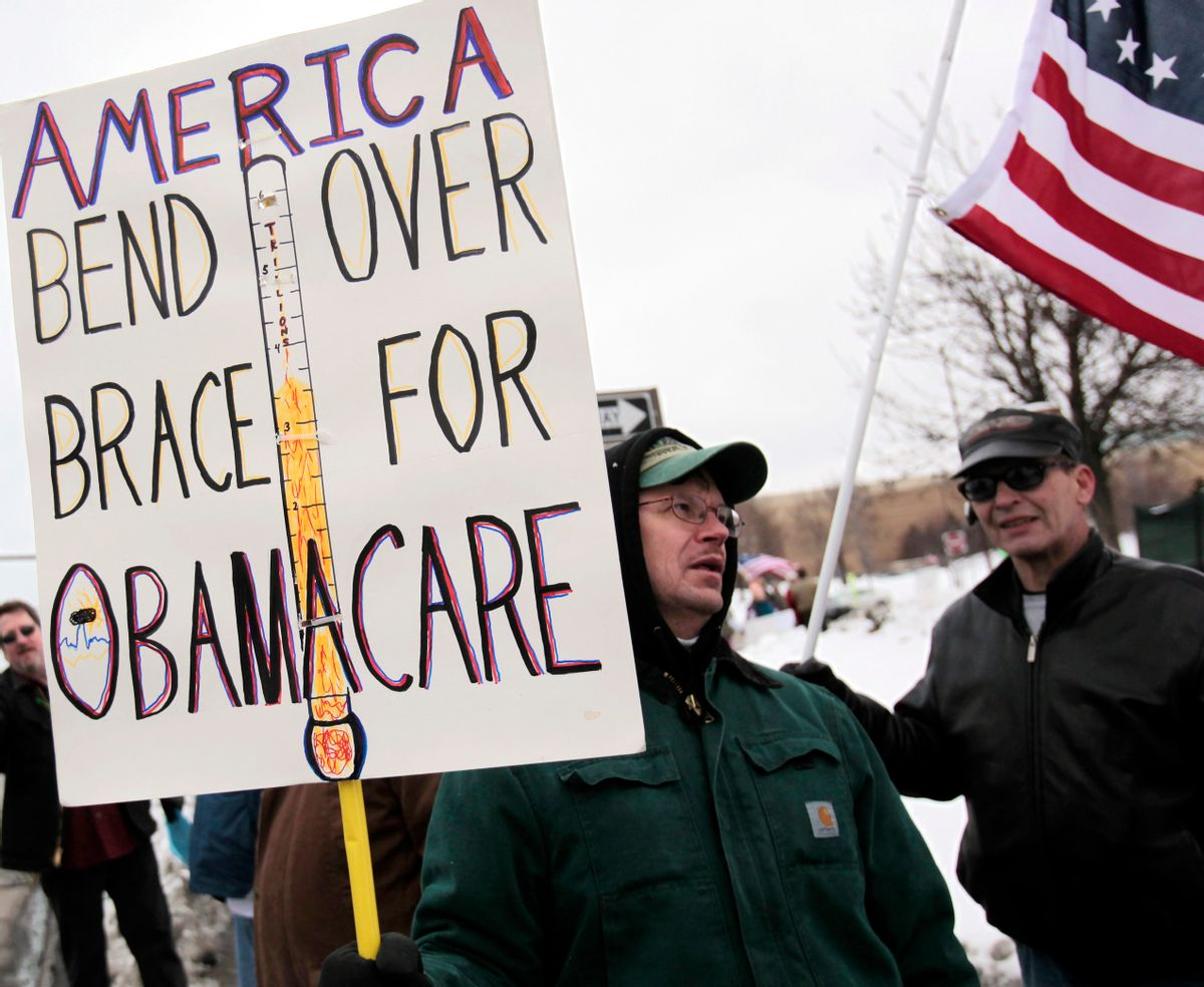 """A Tea Party member carries a sign voicing his concern over """"ObamaCare"""" during a rally marking the one-year anniversary of the movement in Troy, Michigan February 27, 2010. Some Tea Partiers say they can pinpoint the precise moment when they made it clear to the Republican Party they had no intention of being its lapdog. On a bright, brisk afternoon in mid-February, with snow still thick on the ground from storms that had battered Washington the week before, Republican National Committee Chairman Michael Steele met with more than 50 members of the Tea Party, the Twitter Age conservative movement that is reshaping the U.S. political landscape. Picture taken February 27, 2010. To match Special Report USA-POLITICS/TEAPARTY. REUTERS/Rebecca Cook  (UNITED STATES - Tags: POLITICS CIVIL UNREST) (Reuters)"""