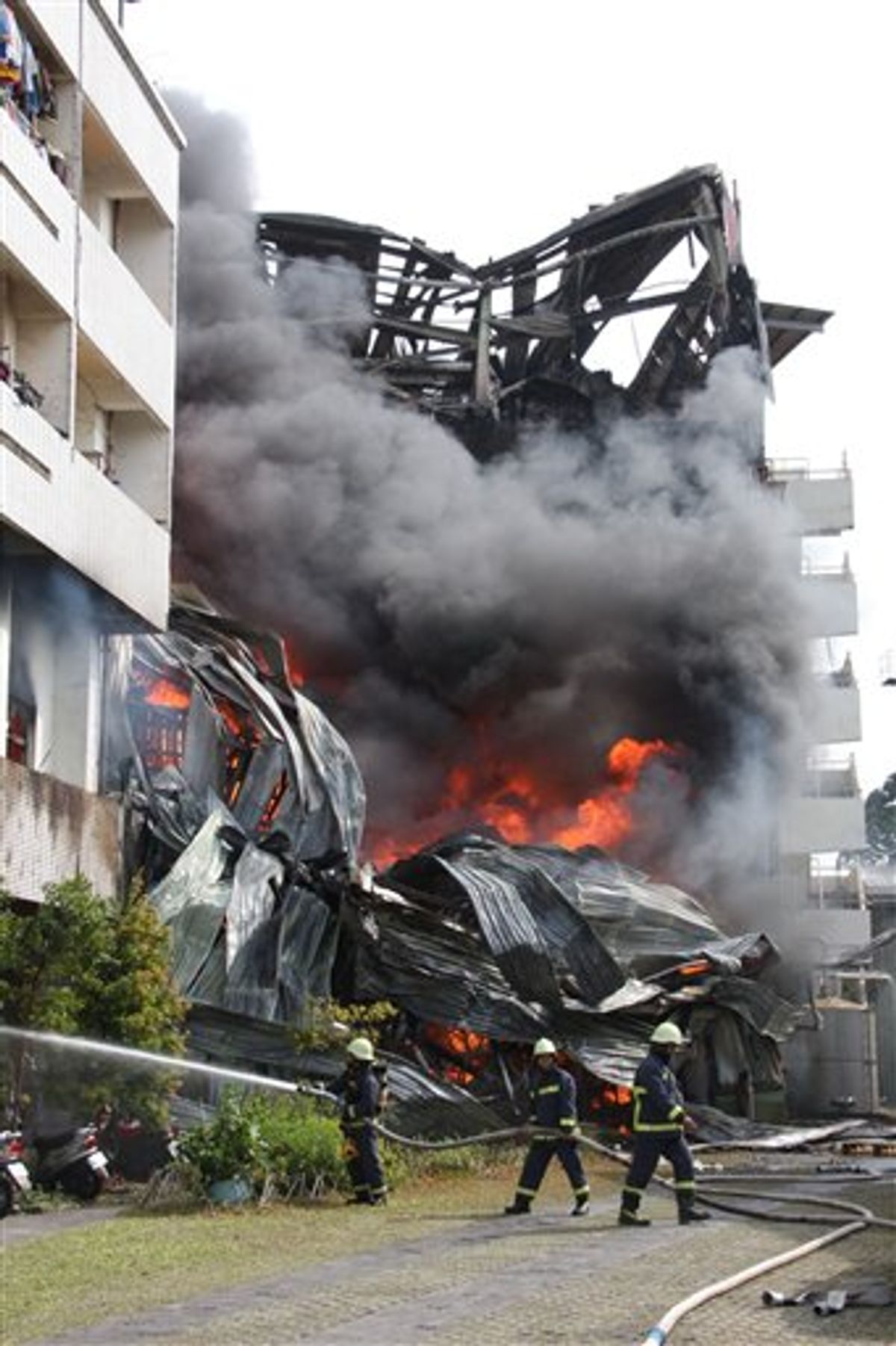 Firemen battle a blaze at a textile factory that started shortly after a strong earthquake jolted the island, Thursday, March 4, 2010, in the southern area of Tainan, Taiwan. A powerful 6.4-magnitude earthquake rocked southern Taiwan on Thursday morning, causing widespread damage, and disrupting communications around the island. (AP Photo) ** TAIWAN OUT ** (AP)
